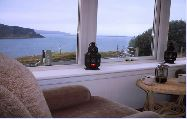 Isle of Skye Cottage Accommodation | Loch Bay Cottage Sleeps up to 6, Stove, Jacuzzi bath, Conservatory, Spectacular Sea Views
